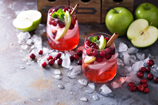 Winter refreshing drink with apples and cranberry