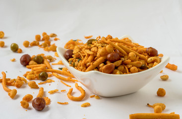 Indian fried snack, namkeen with peanuts, peas on white background