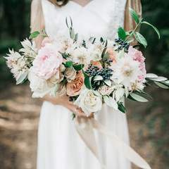 Beauty wedding bouquet in bride's hands