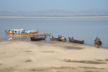 Boats on the banks of the Irrawaddy river. Bagan, Myanmar