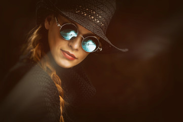Young beauty woman in steampunk round glasses