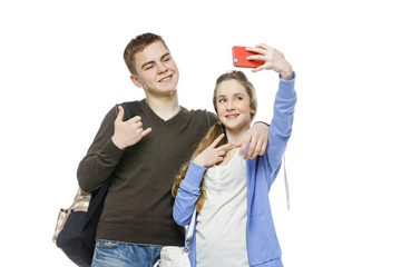 Teen boy and girl taking selfie photo