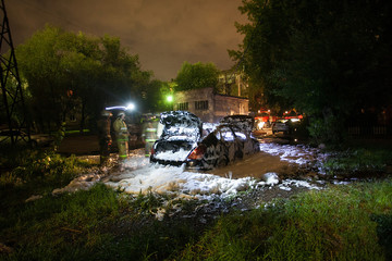 Firefighters extinguished the car at night