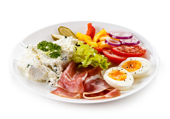 Breakfast - boiled egg, bacon, cottage cheese and vegetables