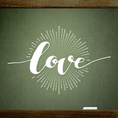 Valentine's background with the words of love, handwritten on blackboard with chalk