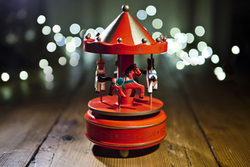 Red carousel toy with blur lights