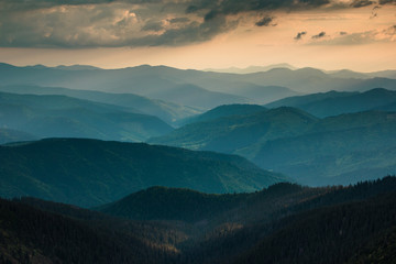 Sunset over layers of mountains.