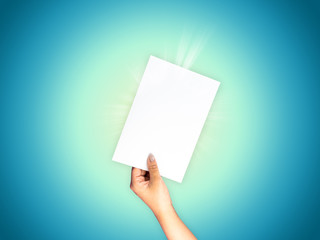 Empty paper on hand holding blue turquoise gradient background