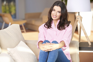 Lovely young woman relaxing on couch  at home