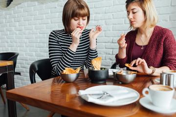 Female friends having breakfast together