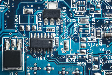 Blue circuit board. Technology and electronics closeup texture.
