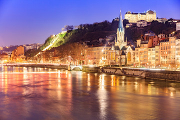 View of Saone river, Famous church in Lyon city at evening
