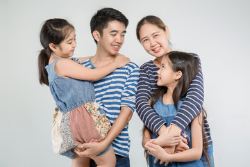 Happy Asian family smiling on isolated background, Happy family enjoying together