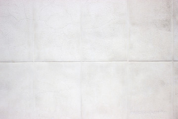 white wall of stone blocks, light texture as background