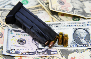 Gun magazine and pistols on dollar banknotes