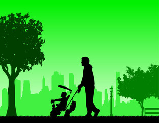 Father walking with his baby a tricycle in the park, one in the series of similar images silhouette