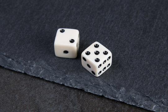 white dice on dark background