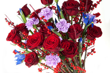 a bouquet of red roses and assorted flowers on white background close up. Valentine's Day