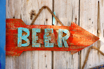 Closeup Beer and Bar Sign on a Rusted Wood Board.