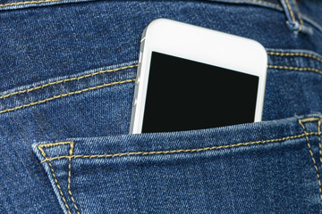 Smartphone in a jeans pocket