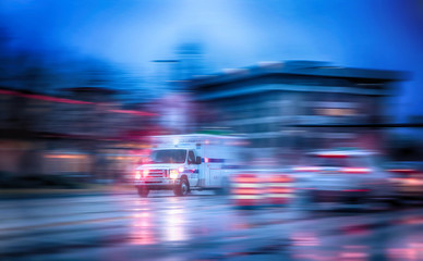 an ambulance racing through the rain on a stormy night with moti