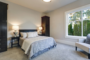 Cozy bedroom interior features soft creamy walls