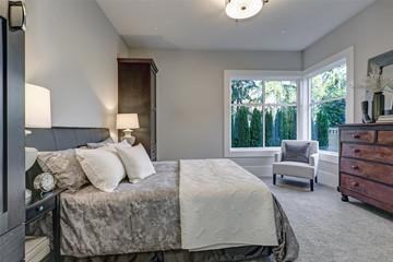 Cozy bedroom interior features soft gray walls
