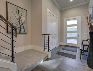 Bright entryway with creamy walls and hardwood floor
