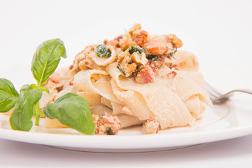 Pasta with cream sauce with bacon, mushrooms, walnuts, spinach