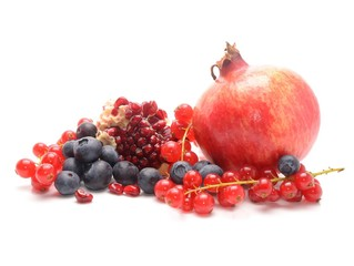 Pomegranate, red currant and blueberries