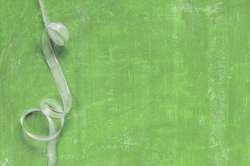 Painted aged green background with ribbon