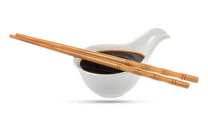 Soy sauce and chopsticks isolated on white