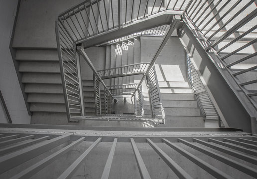 a moody stairwell taken from the top view and done in black and