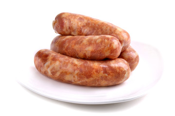 Four raw sausages
