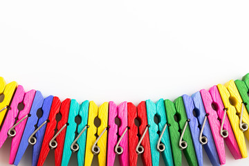 Group colorful clothespin on white background