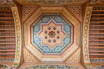 Amazing ornate wooden ceiling in the Bahia Palace of Marrakech, Morocco