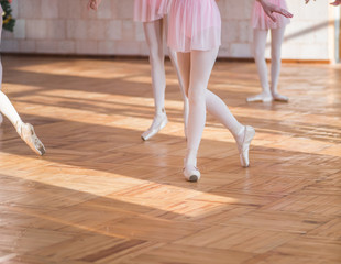 Ballerinas dancing in the ballet hall. Emotional children`s ballet. Soft focus