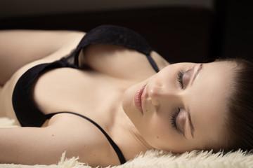 sensual beautiful girl lying on white fur