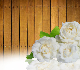 jasmine flowers onwooden background.