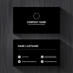 Black paper business namecard on a black wood background
