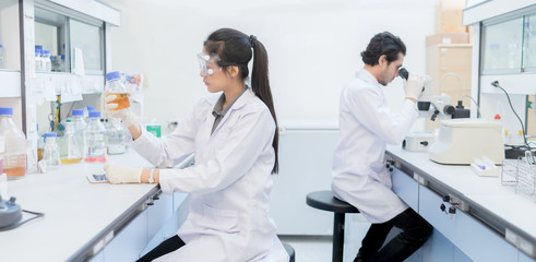 Asian scientist  in the laboratory working at lab with test tube