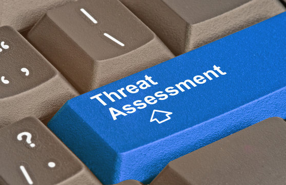 Keyboard with key for threat assessment