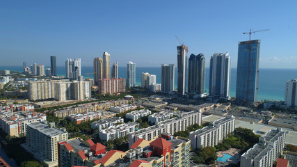 Aerial image of luxury highrise towers in Sunny Isles Beach FL