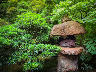 Red Japanese style stone lantern in a garden