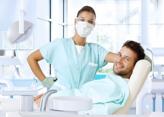 Dental surgeon and patient