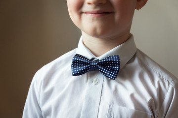 young boy with blue bow tie