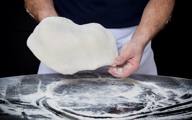 Cook kneads the dough with hands