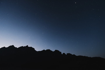 Silhouette mountains line, with clear sky full of star in dawn