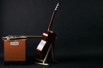 Electric bass guitar and acoustic guitar.Copy space.Back view.