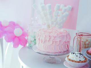 Tasty cake and sweets for birthday party on table